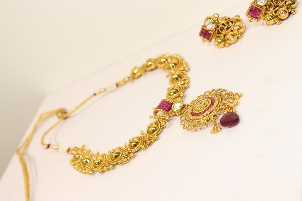 15a92aa819 Buy Exclusive necklace set studded with white and red stones. #redstone  online from The Regalia Grand
